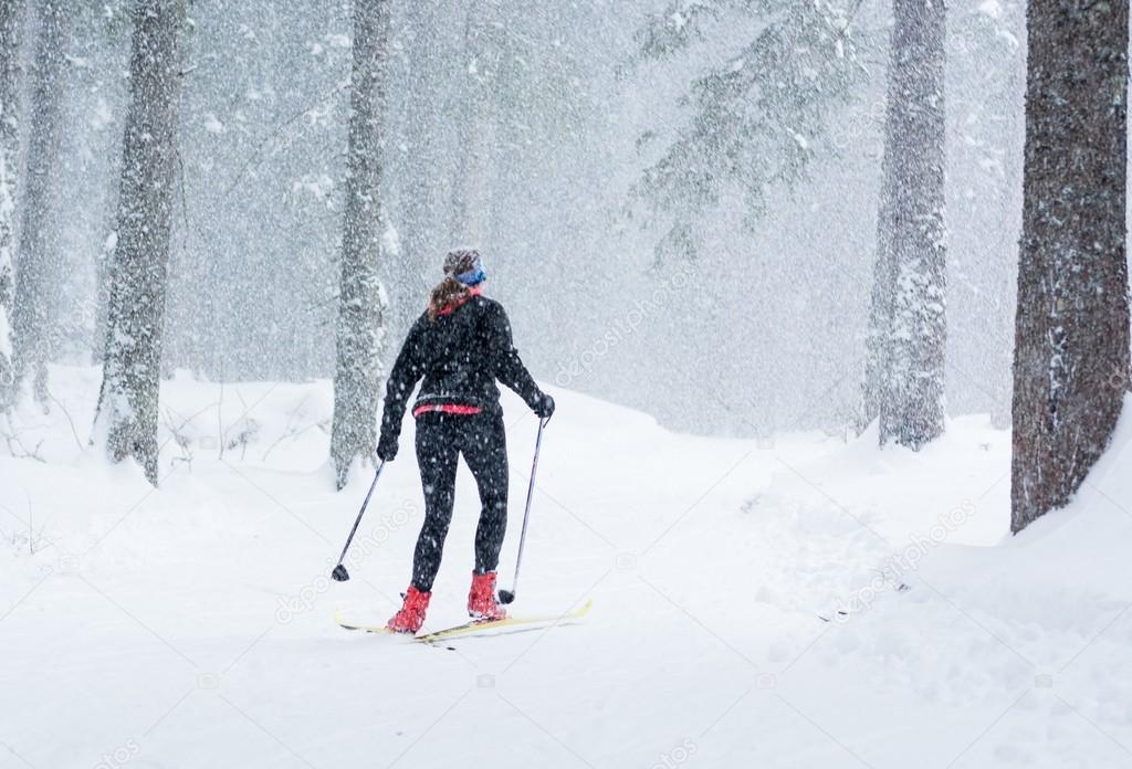 Cross country skiing in bad weather.