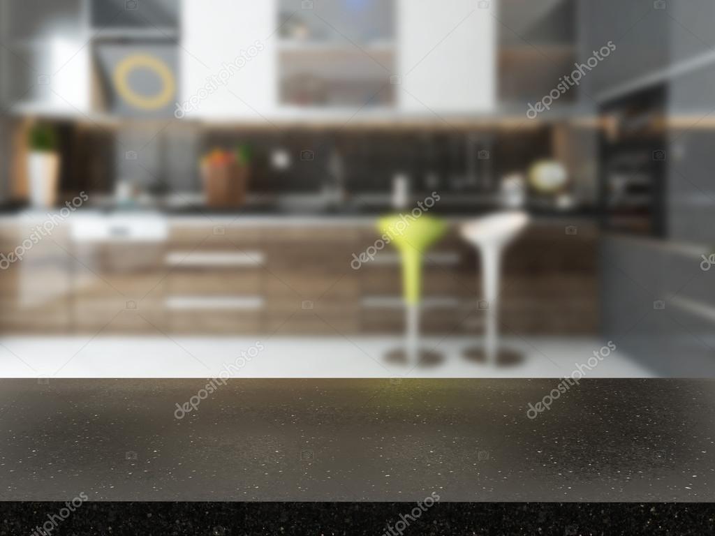 leere schwarzer Granit Schreibtisch mit unscharfen Küche Hintergrund ...