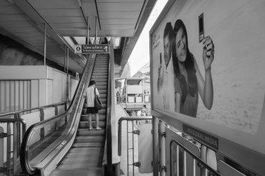 Travellers pass through a BTS Skytrain station