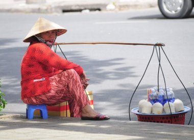 Street vendor selling coconuts in Saigon