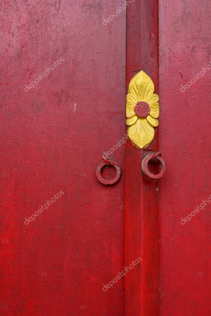 Red wooden door with texture at Khmer temple