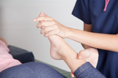 Therapist  giving  a   leg treatment