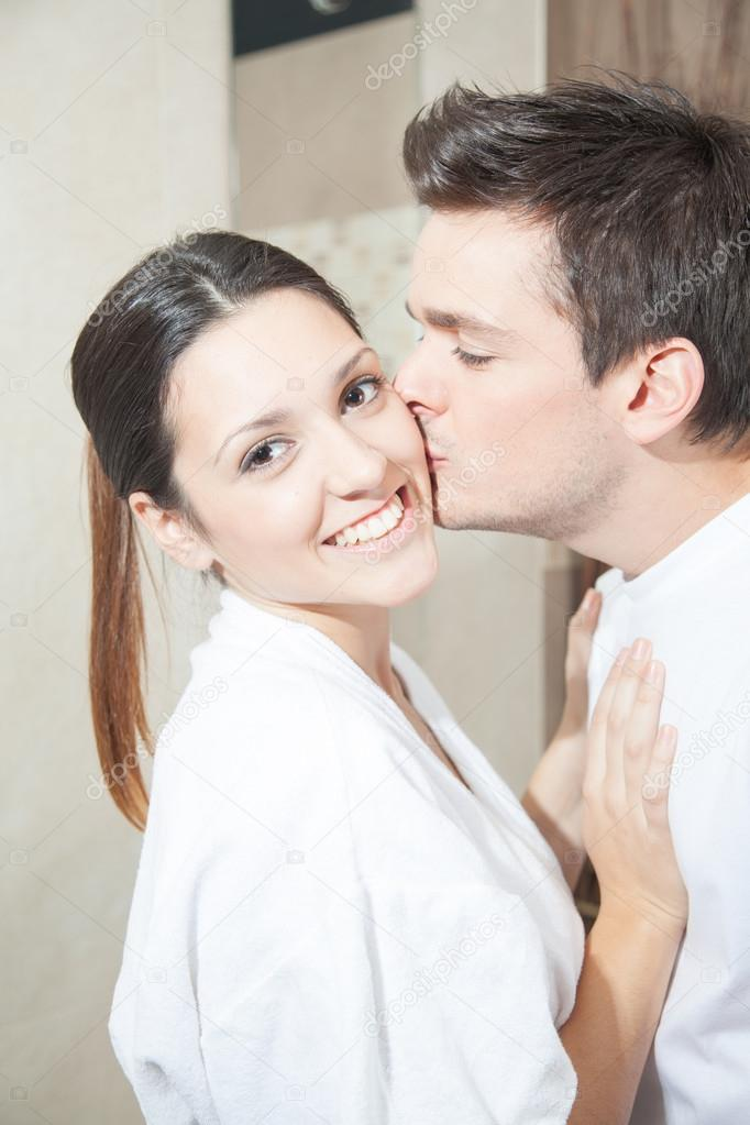 man kissing his woman in bathroom stock photo 122676320