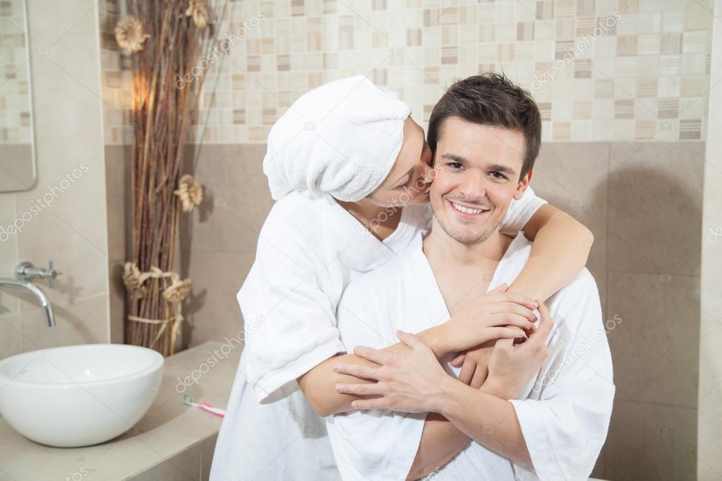 Woman Kissing Her Man In Bathroom Stock Photo C Implementar
