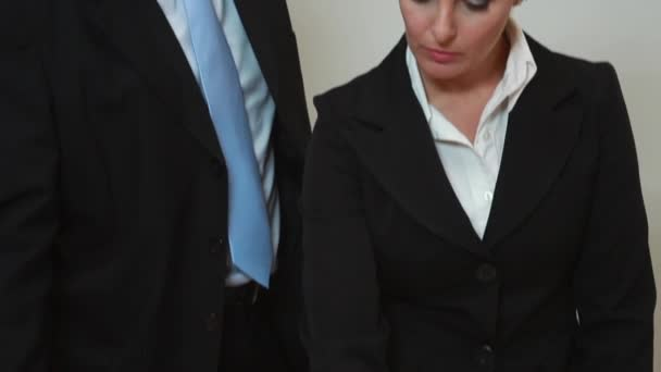 businesswoman and businessman learning documents