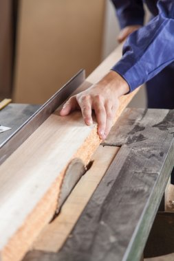 Carpenter cutting a plank
