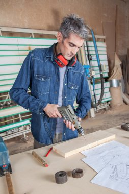 Man working with a drill