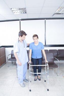 nurse helping a woman with walker