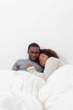 African couple sleeping