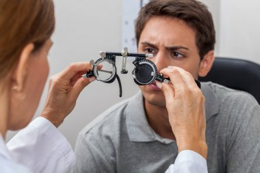 Doctor showing special lenses