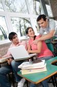 students using laptop