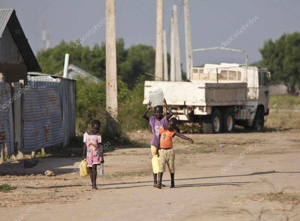 kids carrying water, South Sudan