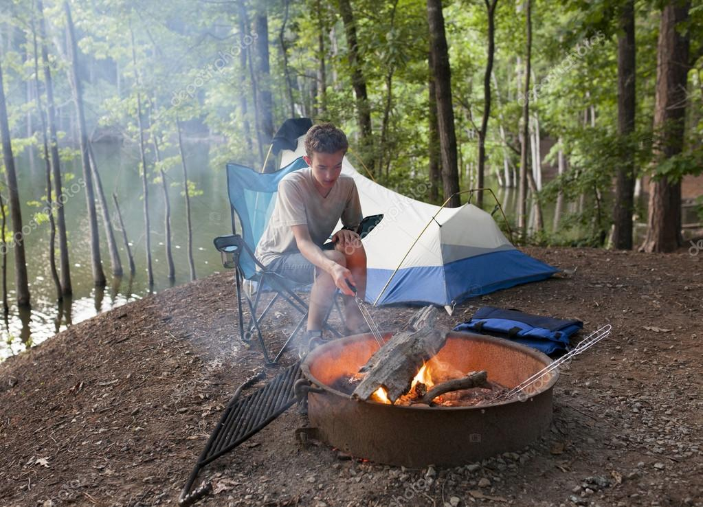 teenager camping with camp fire