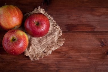 juicy apples on a wood background