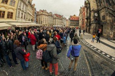 Tourists watch astronomical clock in Prague