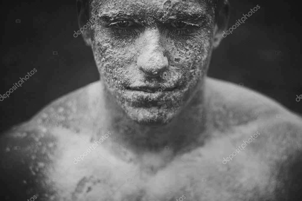 Mud dirty flies in the facee man