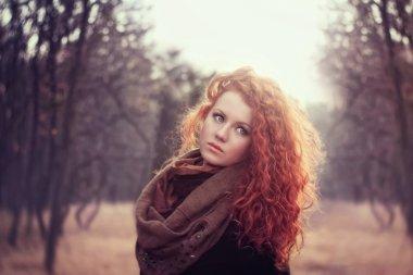 beautiful redhead  girl outdoor