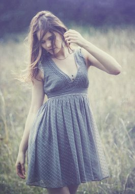 Beautiful woman  blu dress outdoor in field