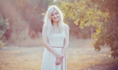 beautiful young woman in white dress with long snow-white hair o