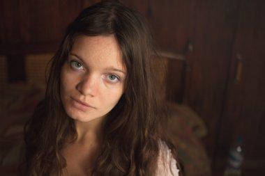 Pretty woman portrait in a warm room
