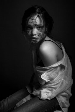 Emotional fashion portrait of a young attractive woman in studio