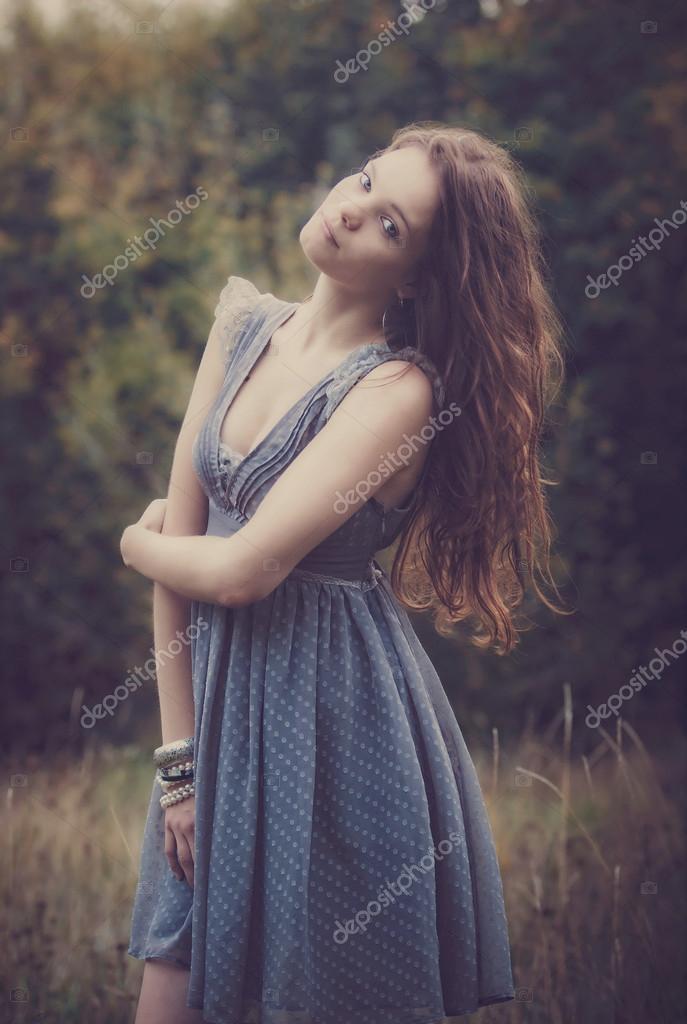 Beautiful woman  blu dress outdoor in field