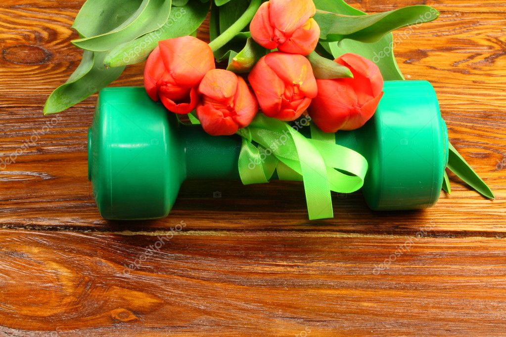 gift of flowers and dumbbells for fitness