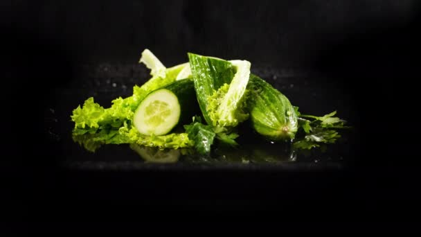 Spraying Cucumbers with Green Lettuce Leaves