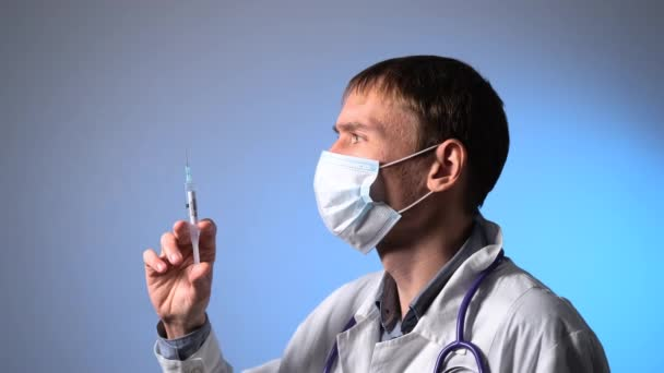 Male Doctor Prepares for COVID Vaccination Shot