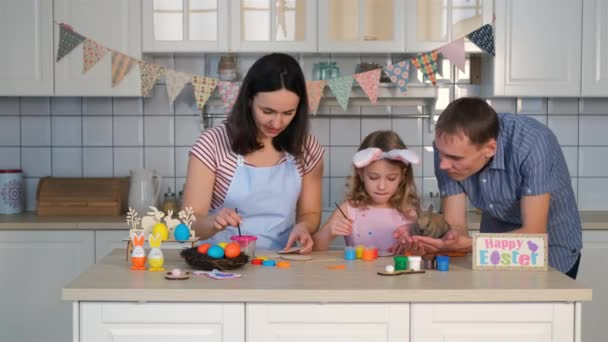 Family Preparing Easter Decorations in Kitchen