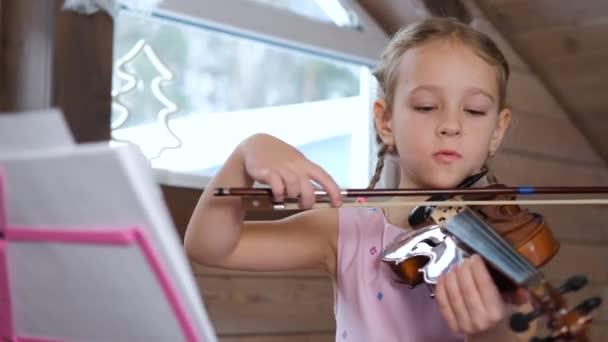 Child Playing Violin and Singing Song at Home