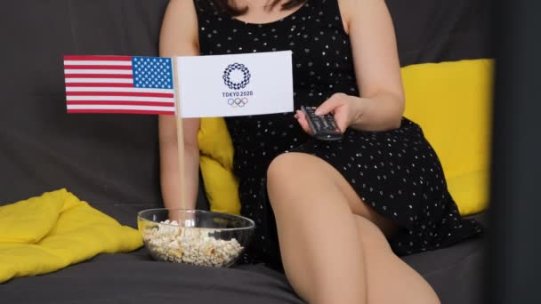 Woman Watching Tokyo Olympic Summer Games on TV
