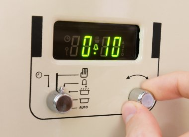 Setting a cooker timer.