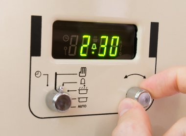 Setting a cooker timer to 2 hours 30 minutes