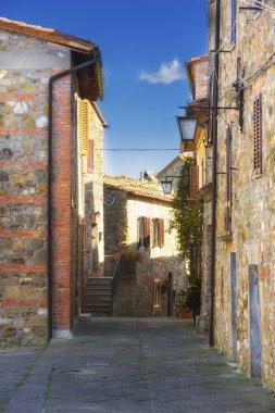 Streets of tiny ancient town in Tuscany, Contignano. stock vector