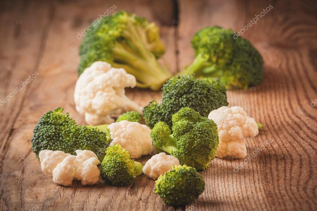 Delicious broccoli and cauliflower has a wooden rustic table