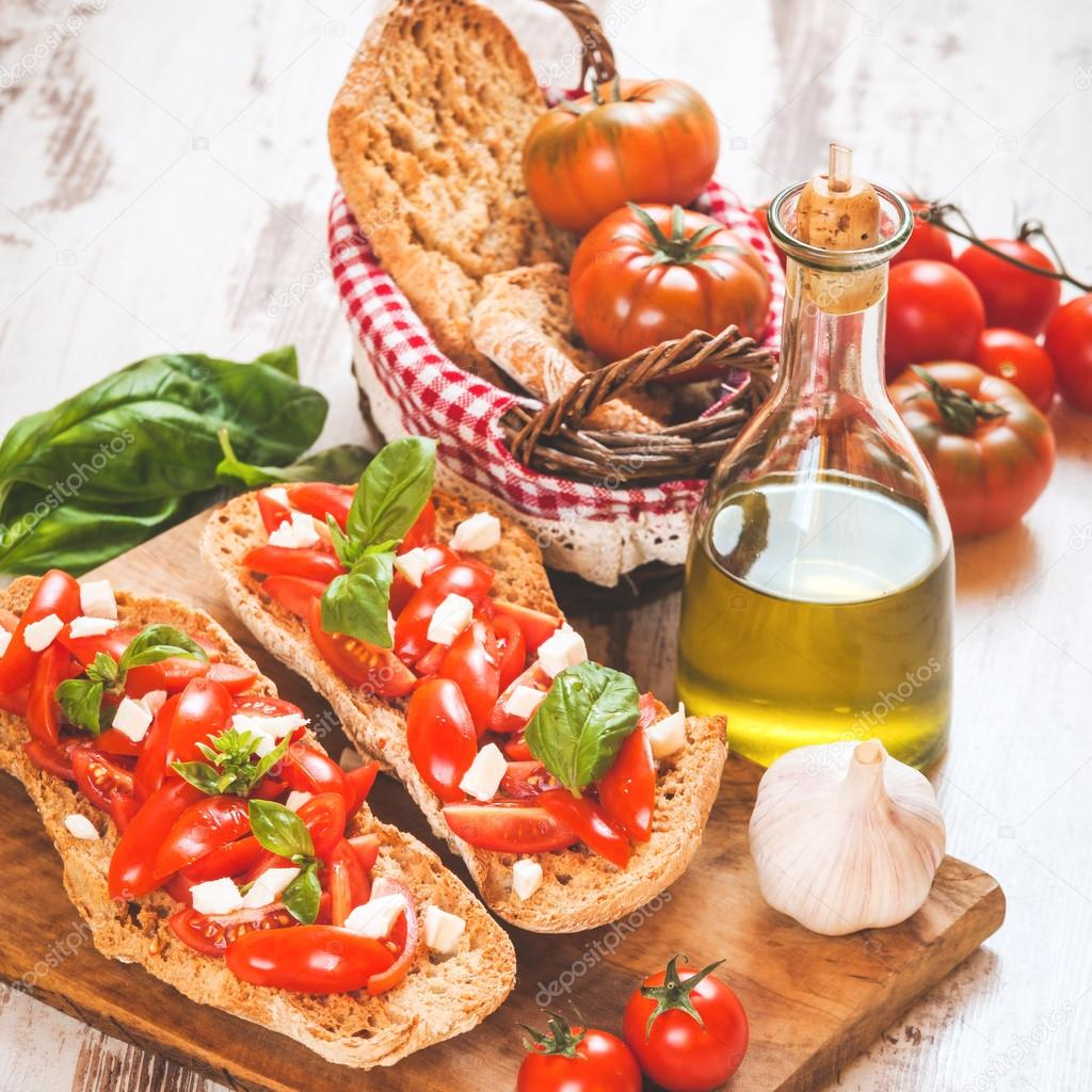 Italian starter, bruschetta with Sicilian red fresh tomato and m