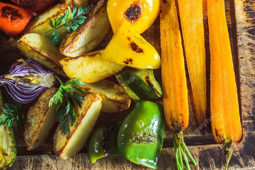 Grilled spring vegetables on a wooden board.