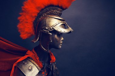 Mannequin in helmet with red feathers