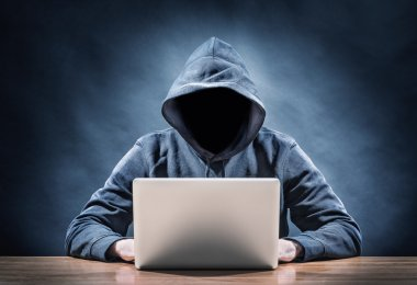 Picture of a hacker on a computer stock vector