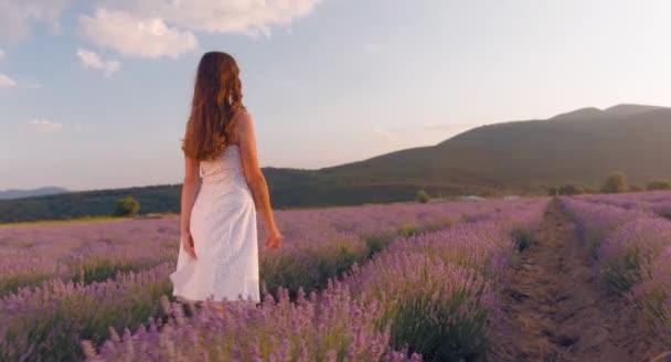 Woman Walking on Lavender Field