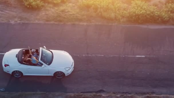 Aerial Flight Over Convertible Car Driving Down Beach Road At Sunset Couple Enjoying Summer Vacation Adventure Freedom Concept