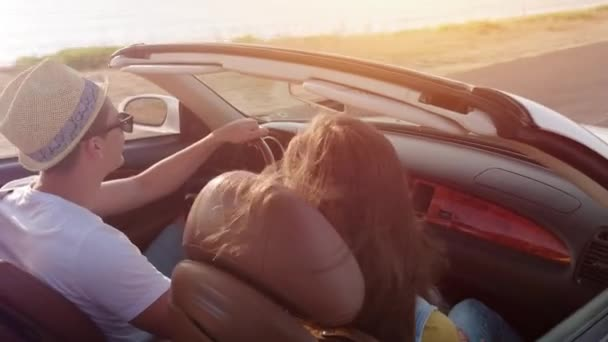 Young Man And Woman Driving A Convertible On Sea Road Beach Front Enjoying Summer Happiness Vacation Adventure Travel Luxury Car Exotic Destination Concept