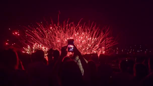 New Years Eve Crowd Watching Fireworks Recording On Smartphone Taking Pictures Technology Celebration Memories Concept