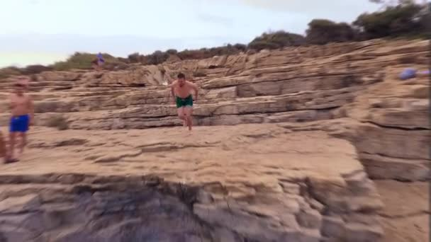 Athletic Young Man Jumping From Cliff Into Ocean Sea Water Muscular Adventure Extreme Sports Lifestyle Hobby Vacation Clear Beach Slow Motion Exotic Island Location
