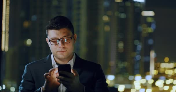 Young Businessman Using Smartphone City Sky Scrapers Urban Landscape Successful Ap Startup Night Downtown Slow Motion Red Epic 8k