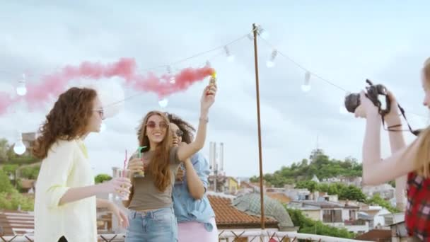Group Of Diverse Teen Girls On Rooftop Smiling And Posing Holding Smoke Torch Taking Pictures With Dslr Camera Fashion Photography Happy Vacation Photoshoot Music Party Celebrating Togetherness Unity