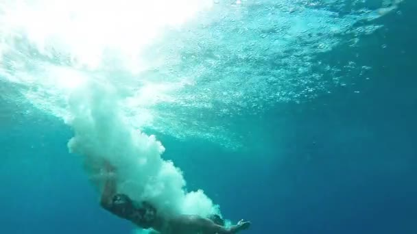 Two Young Men Jumping Into Deep Blue Sea Water Ocean Tropical Location  Freedom Exotic Modern Active Lifestyle Hobby Underwater Bubbles Splash  Muscular Fit Body Healthy Concept HD Gopro