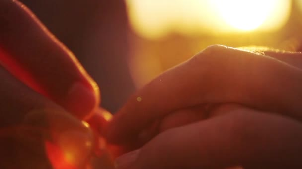 Proposal Putting on Engagement Ring sunset hands