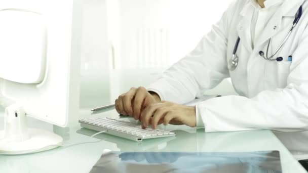 Medical Doctor Hands Typing on Keyboard PC Researching Concept